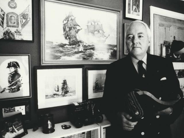 Douglas Reeman in his study (photo copyright The Surrey Advertiser).