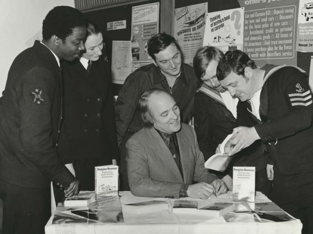 Signing books at HMS Collingwood, Gosport.
